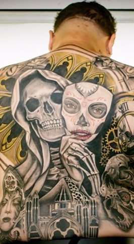 full chicano back piece tattoo
