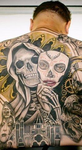 full chicano back piece tattoo